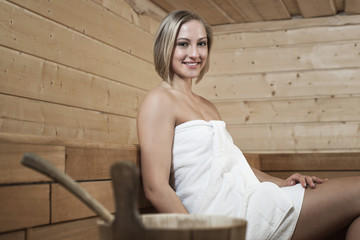 Young woman in a sauna