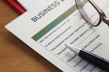 selective focus pen,Business loan application form ,glasses,pape