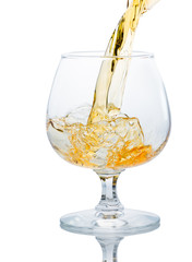 A glass of brandy on a white background.