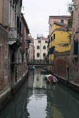 Rainy day. Narrow canal in Venice. Venice. Italy