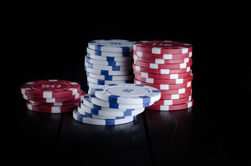 Poker chip on black background