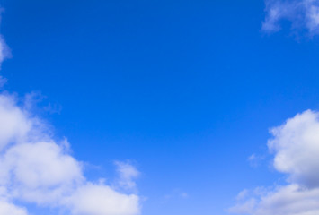 Bright blue sky and white clouds. Background. Horizontal shot, the theme - the sky, nature.
