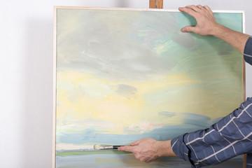 An artist hands painting in studio. Selective focus