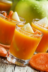 Freshly squeezed juice of carrots and green apples, selective fo