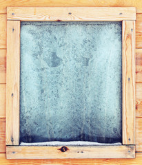 Icy window in a wooden house