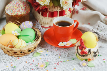 Table setting for Easter - Easter cakes, coffee cup and colored