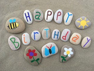 Happy Birthday with stones design composition