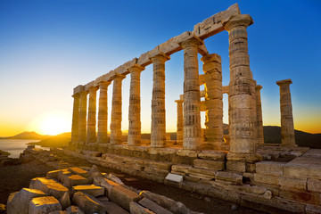 Aluminium Prints Ruins Greece. Cape Sounion - Ruins of an ancient Greek temple of Poseidon before sunset