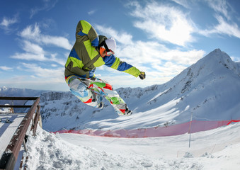 Snowboarder in the free jumping
