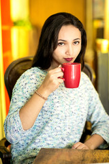 Young woman with a cup of coffee in the morning