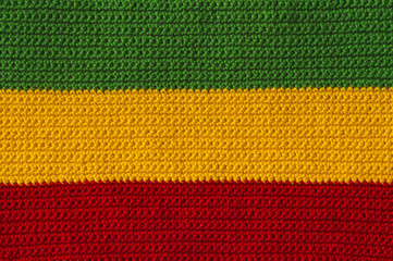 Handmade green, yellow, red crochet colorful background.