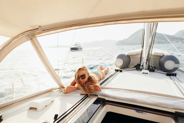attractive girl yachting in swimwear relax on vacation trip