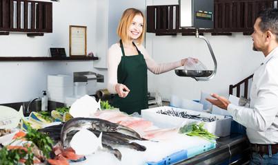 Shopgirl in fresh fish store