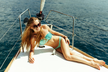 sexy girl yachting in swimwear relax on vacation