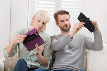 Couple Looking At Empty Wallet