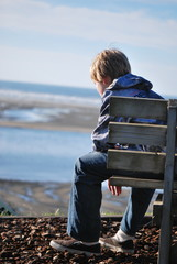Young Boy On Bench