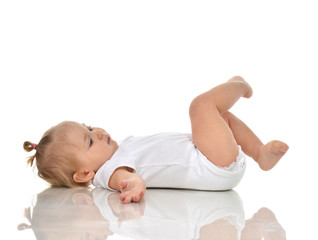 Funny Infant child baby girl in diaper lying on a back and looki