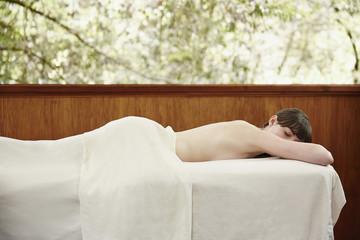 Caucasian woman having massage in spa