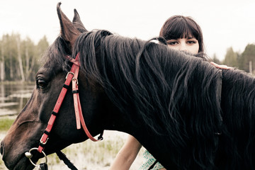 Caucasian woman with horse outdoors