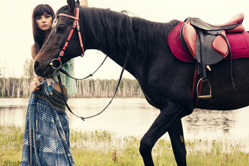 Caucasian woman walking with horse outdoors