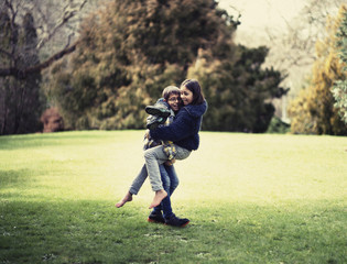 Mixed race brother and sister playing in field