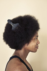 African American man wearing comb in afro hairstyle