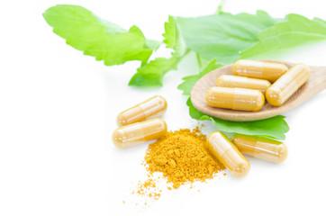 Yellow herbal medicine powder and capsules.