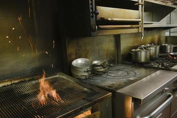 Flaming grill in restaurant kitchen