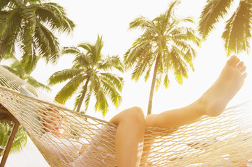 Low angle view of Caucasian woman laying in hammock
