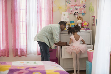 Father and daughter picking out ballet clothing