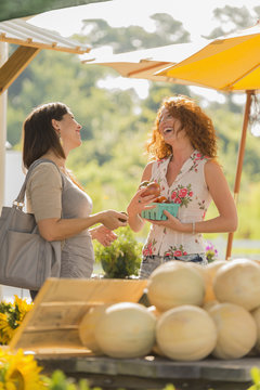 Woman laughing at farmers market