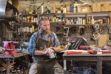 Caucasian craftsman working in workshop