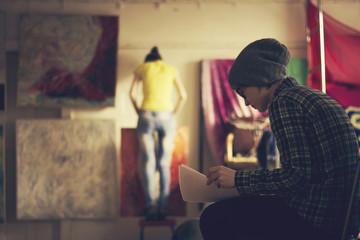 Caucasian artists working in studio