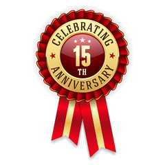 Gold 15th anniversary badge, rosette with red ribbon on white background