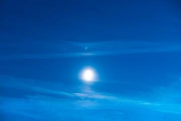 Blue dark night sky with moon