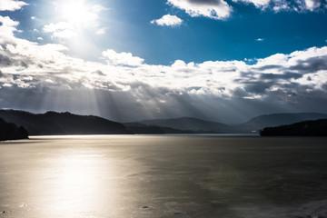 Sun beams over frozen lake