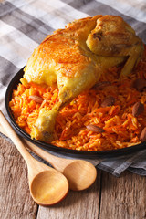 Kabsa - spicy rice with vegetables and chicken close-up. vertical