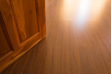 wood laminate floor and wooden door open