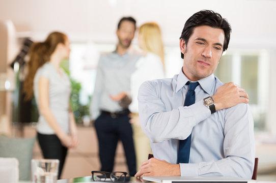 Stressed businessman having neck pain