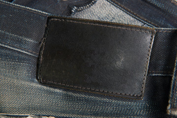 Leather tag on black jeans