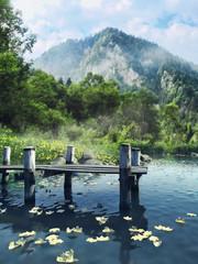 Wall Mural - Drewniane molo na jeziorze w górach