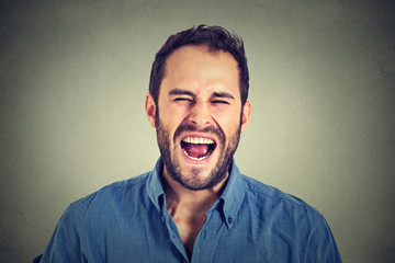 portrait of young angry man screaming