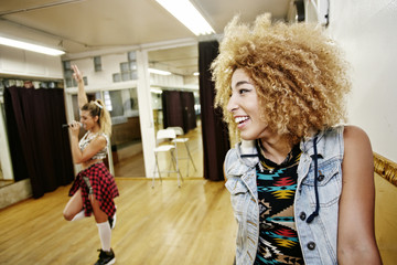 Dancer and singer rehearsing in studio