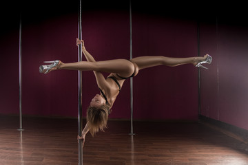 athletic girl dancing with a pole, a professional athlete trains