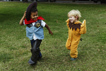 Boys playing in costumes in park