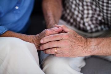 Senior couple holding hand