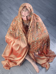 portrait of a man with beige scarf