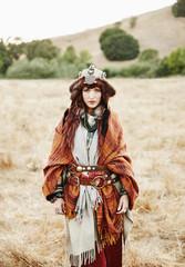 Nomadic Caucasian woman standing in field