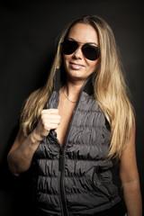 Beautiful woman model with black sunglasses.Studio portrait