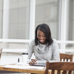African American businesswoman using digital tablet in office